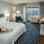 THE NEWPORT HARBOR Hotel and Marina recently completed a renovation and redesign of 133 guestrooms. The suite pictured above has a walkout and a view of Newport Harbor. /COURTESY AARON USHER III PHOTOGRAPHY