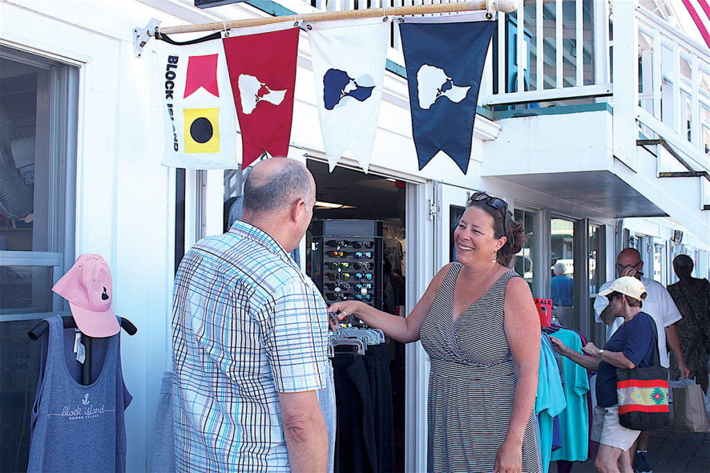 Block Island Tourism Council Executive Director Jessica K. Willi speaks with B.I. Tees owner John Cullen. / PBN FILE PHOTO/K. CURTIS