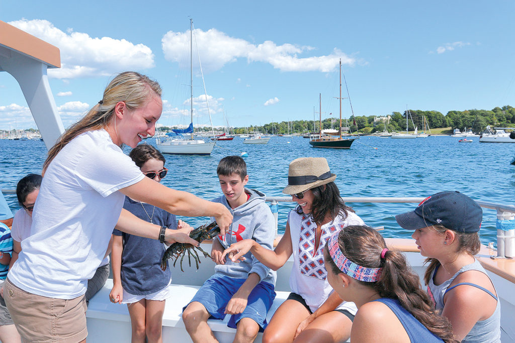 Customers get up close and personal with a lobster during a Fish'n Tales Adventure excursion. / COURTESY DISCOVER NEWPORT
