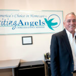 CAREGIVER: Visiting Angels Rhode Island owner John Gormly at the VARI office in East Providence.  / PBN PHOTO/MICHAEL SALERNO