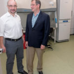 BIOTECH SUPPORT: Russ Yukhananov, left, president of Mansfield Bio-Incubator, and Alexander Margulis, chief operating officer, stand in front of one of their bio-safety cabinets. / PBN PHOTO/MICHAEL SALERNO