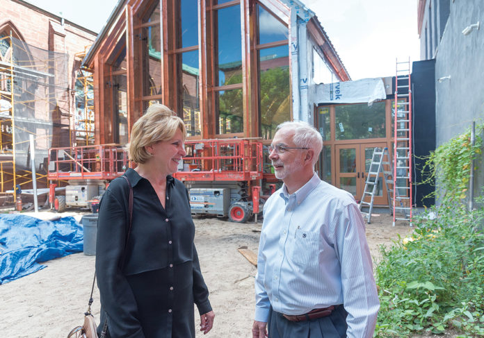 HISTORIC SITE: Charles A. Morton and Colleen B. Titmas are co-owners of Bowerman Associates Inc., which is handling the parish-hall addition to the historic Grace Episcopal Church, above, at 300 Westminster St. in Providence. / PBN PHOTO/MICHAEL SALERNO