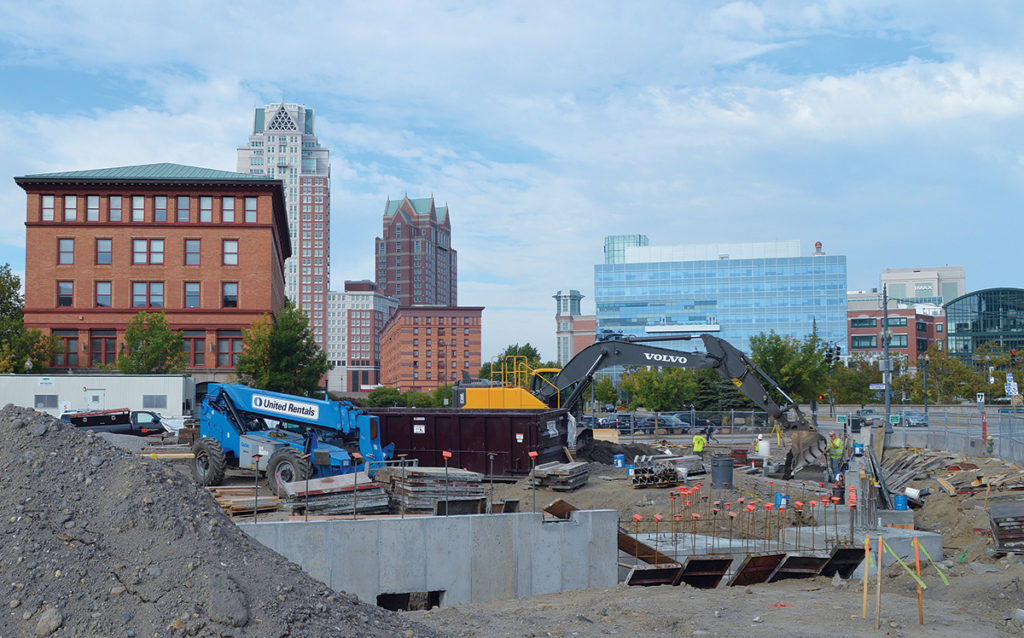 """Hilton Homewood SuitesExchange Street, ProvidenceA 120-room """"all-suites hotel"""" is coming to Providence next November. First Bristol Corp. tasked Tocci Builders Inc. with constructing a Hilton Homewood Suites in August at the city's triangular lot known as """"Parcel 12."""" The 105,000-square-foot hotel will boast oversized rooms, full kitchens and appliance packages, meeting rooms, fitness center, guest restaurant and outdoor patio area overlooking the Providence River. The $25 million project includes parking for 50 cars in an enclosed parking garage on the ground level. The project architect is ZDS Architectural Design, with engineers VHB and GZA GeoEnvironmental Inc. / PBN PHOTO/NICOLE DOTZENROD"""