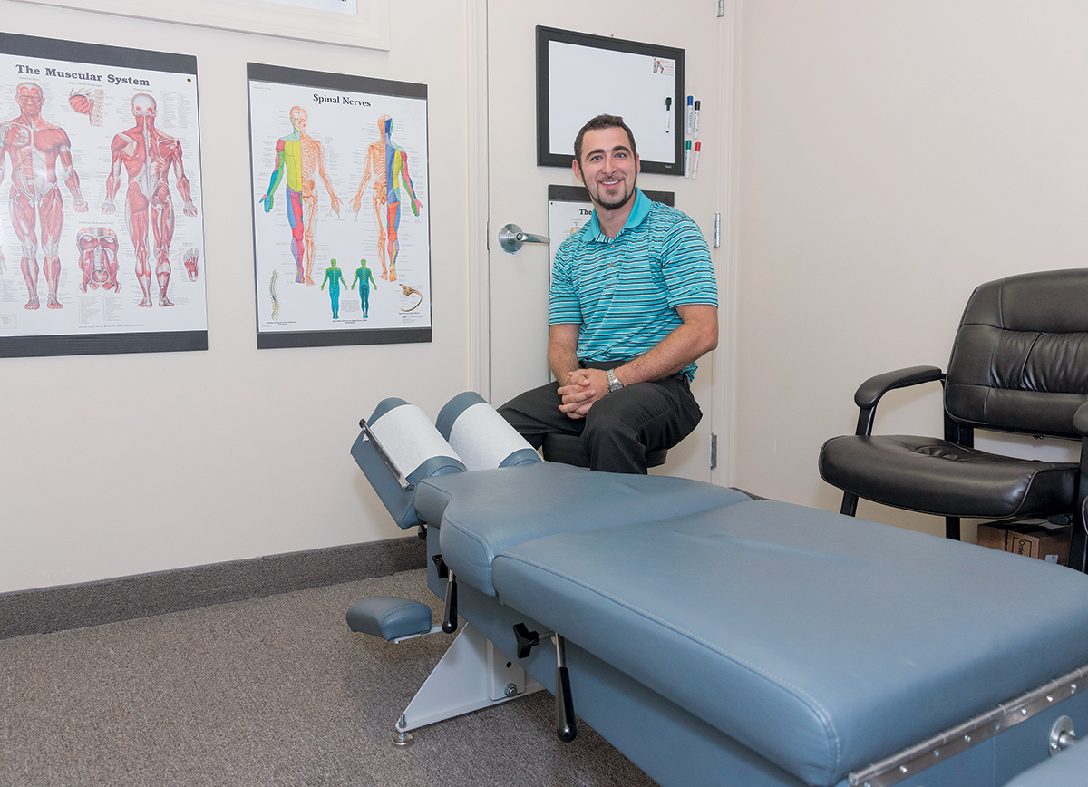 OPIOID ALTERNATIVE: Dr. Benjamin Algiere, owner of Algiere Chiropractic in Richmond, opened his practice eight months ago. He says many patients worry about building up a tolerance for opioids and would prefer alternative treatment. / PBN PHOTO/MICHAEL SALERNO