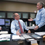 STAYING AFLOAT: Mark A. Male, left, executive vice president of the Independent Insurance Agents of Rhode Island, speaks with Sean Donaghey, senior vice president, state account executive. Male thinks flood-insurance rates will increase due to recent hurricanes. / PBN PHOTO/MICHAEL SALERNO