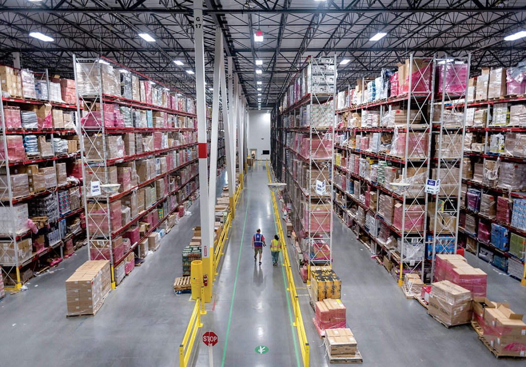 AGGRESSIVE GROWTH: Pictured is the interior of the Amazon fulfillment center in Fall River. According to retail analysts at Needham and Co. LLC, Amazon posted $128.5 billion in gross merchandise sales in 2016, 34 percent of all U.S. online sales, and accounted for 58 percent of all e-commerce growth in the country that year.  / PBN PHOTO/MICHAEL SALERNO