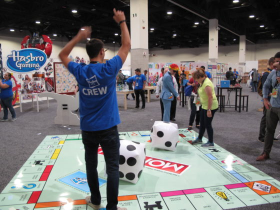 HasCon staff and attendees take turns throwing dice on a larger-than-life Monopoly board. PBN PHOTO/NICOLE DOTZENROD