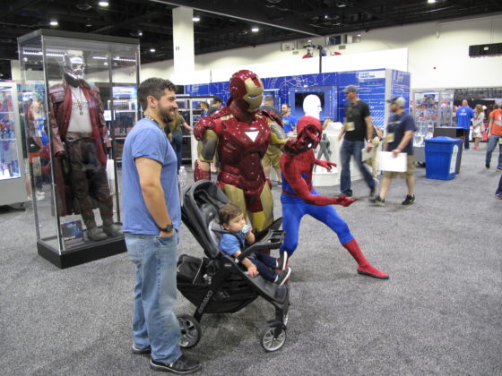 Guests pose with Iron Man and Spider-Man at HasCon. PBN PHOTO/NICOLE DOTZENROD