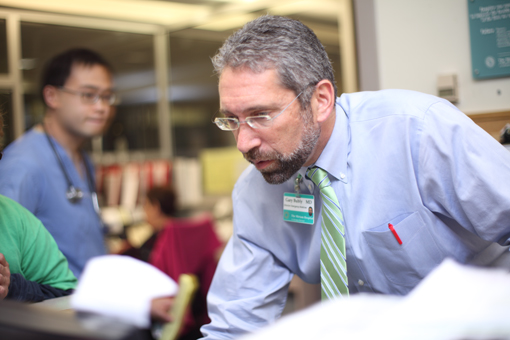 THE WARREN ALPERT Medical School of Brown University and the University Emergency Medicine Foundation have named Dr. Gary Bubly, foreground, the inaugural vice chair for clinical integration and innovation at its Department of Emergency Medicine. / COURTESY BROWN UNIVERSITY