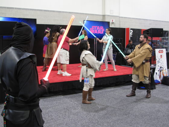 HasCon attendees try their hand at lightsaber duels. PBN PHOTO/NICOLE DOTZENROD