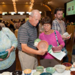 ATTENDEES OF LAST YEAR'S Empty Bowls fundraiser choose their keepsake bowl. The annual event by the Rhode Island Community Food Bank is scheduled for Oct. 13 this year. / COURTESY RHODE ISLAND COMMUNITY FOOD BANK