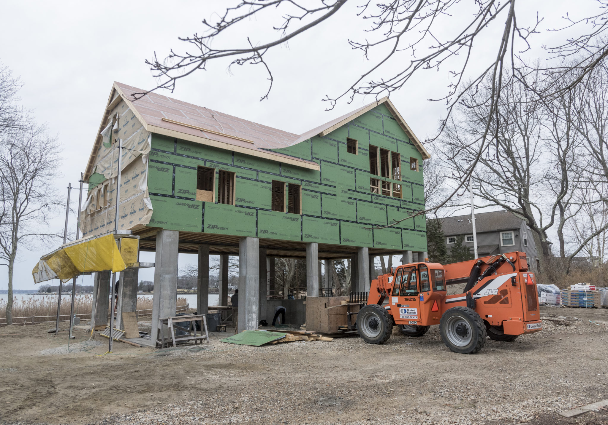 "A NEW WAY TO BUILD: This ""fortified"" house built by Caldwell & Johnson fronts a saltmarsh and Narragansett Bay in Wickford village in North Kingstown and has structural improvements that make it resistant to wind, rain, sea level rise, and other environmental factors. PBN FILE PHOTO/MICHAEL SALERNO"