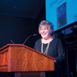 GRATEFUL: The late Sylvia Moubayed, owner of Cav Restaurant in Providence, speaks during the Providence Warwick Convention & Visitors Bureau's annual meeting in 2013, in which she was named the CVB member of the year.  / COURTESY PROVIDENCE WARWICK CONVENTION & VISITORS BUREAU