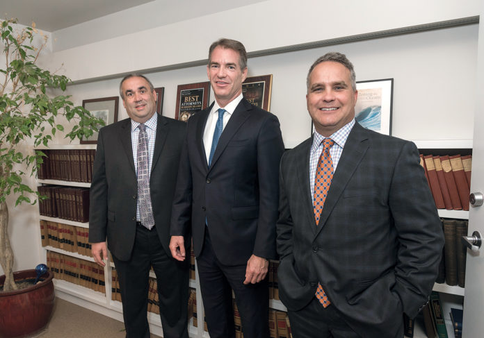 SECURE SITE: The owners of Pilgrim Title Insurance Co., from left, Christopher Montalbano, vice president; James Belliveau, president; and Jeffrey St. Sauveur, vice president. The company recently launched a new digital closing system that cuts down on paperwork and expedites the process by storing documents on a secure website. / PBN PHOTO/MICHAEL SALERNO