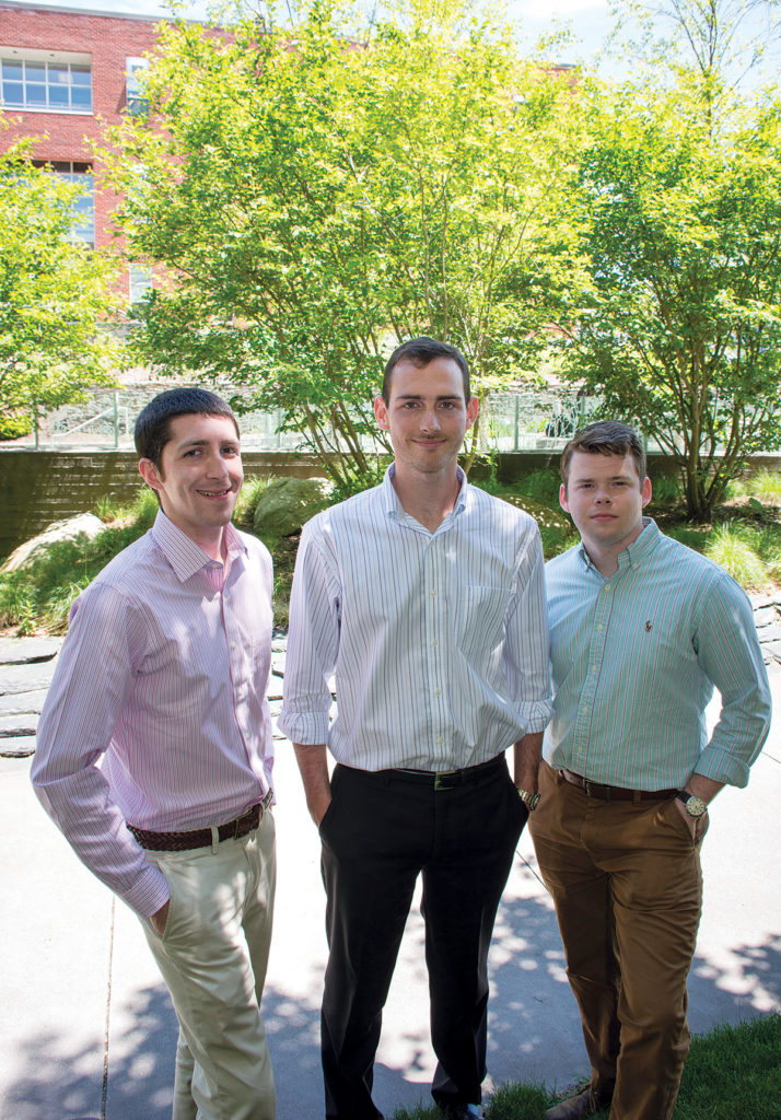 INSPIRED: From left, Nicholas DaSilva, Benjamin Barlock and Kenneth Rose, Ph.D. students at the University of Rhode Island's College of Pharmacy, discuss the drug-development company they launched, Alcinous Pharmaceuticals. / COURTESY URI/NORA LEWIS