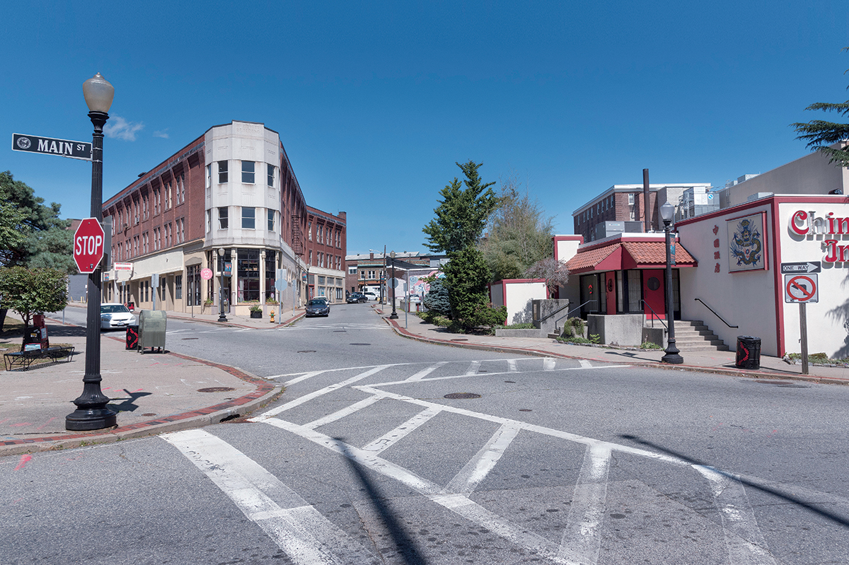 GHOST TOWN: With few shoppers or passersby on the sidewalks, even during weekday hours, Main Street in downtown Pawtucket resembles more of a ghost town than an active city center. City officials hope a new train station and a new ballpark for the Pawtucket Red Sox will lead to further development. / PBN PHOTO/MICHAEL SALERNO