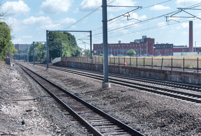 ALL ONBOARD? The planned location of the new Pawtucket-Central Falls Commuter Rail Station is near the small structure on the left side of the tracks and runs across the tracks on both sides. / PBN FILE PHOTO/MICHAEL SALERNO