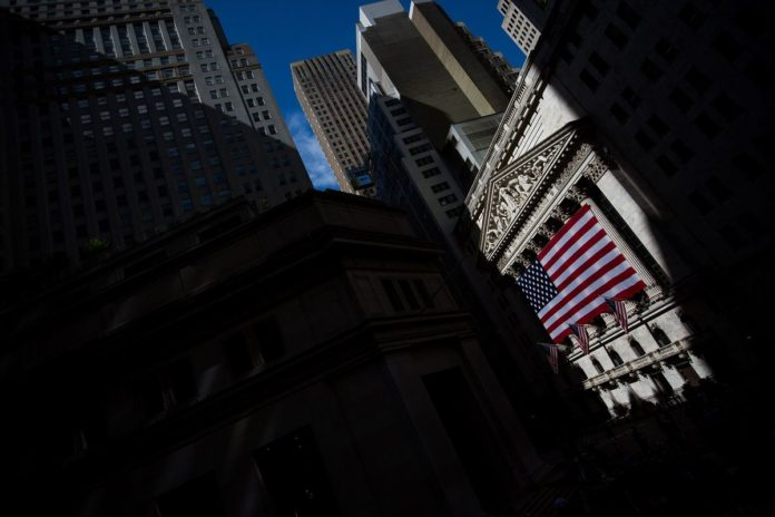 THE DOW JONES Industrial Average briefly rose above 23,000 Tuesday, a record high. / BLOOMBERG FILE PHOTO/MICHAEL NAGLE