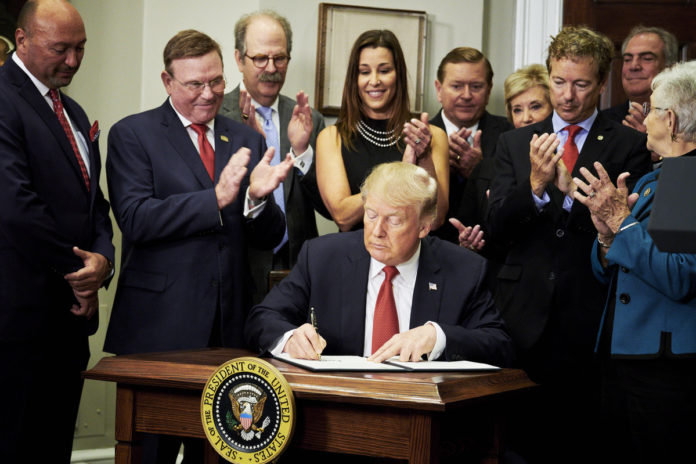 PRESIDENT DONALD J. TRUMP signs an executive order on health care in Washington, D.C., on Oct. 12, 2017. / BLOOMBERG FILE PHOTO/T.J. KIRKPATRICK