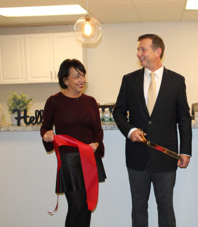 DEBORAH PARENTE, left, office manager, and Dr. Stephen Estner, owner, cut the ribbon at the grand opening of Estner Injury Center's new location at 2191 Post Road in Warwick. / COURTESY WARWICK DEPARTMENT OF TOURISM, CULTURE AND DEVELOPMENT