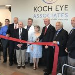 FROM LEFT ARE Dr. Thandeka Myenim and Scott Bowers of Koch Eye Associates; Kelly MacArthur Coates of Carpionato Group; Dr. Ronald O. Furman;, Dr. Lionel Lemos; Dr. Patricia Koch of Koch Eye Associates; Warwick Mayor Scott Avedisian; Dr. Paul Koch of Koch Eye Associates; and Michael St. Onge of Claris Vision during a ribbon-cutting ceremony for the new Koch Eye Associates family eye care center in Warwick. / COURTESY JS COMMUNICATIONS