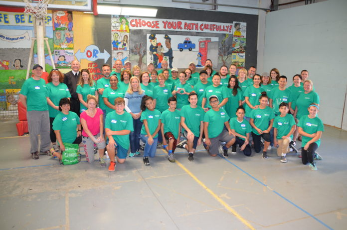 APPROXIMATELY 100 NEIGHBORHOOD HEALTH Plan of Rhode Island employees helped repair and paint the Pawtucket Tides Family Services facility in September. / COURTESY NEIGHBORHOOD HEALTH PLAN OF RHODE ISLAND