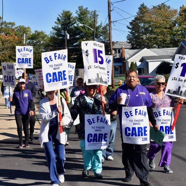 ABOUT 150 NURSING HOME workers picket outside of Pawtucket Genesis Nursing home on Oct. 17, calling for a $15-per-hour starting wage. / COURTESY DISTRICT 1199 SEIU NEW ENGLAND