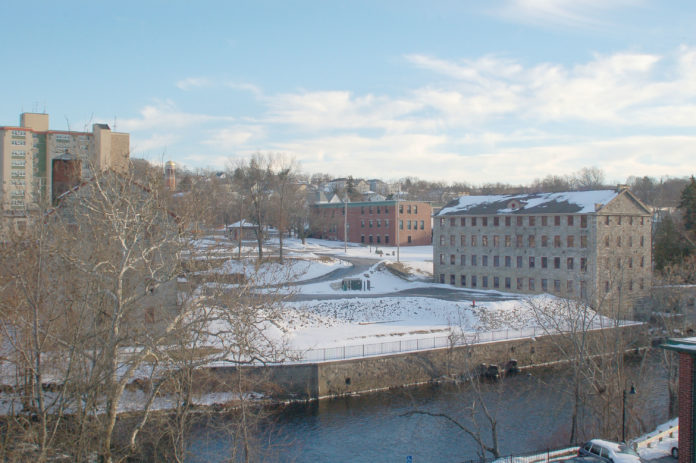 The former Woonsocket Co. Mill complex is shown in this 2013 photo. Owners have been awarded state historic-preservation tax credits to renovate some of the buildings. COURTESY HISTORICAL PRESERVATION AND HERITAGE COMMISSION
