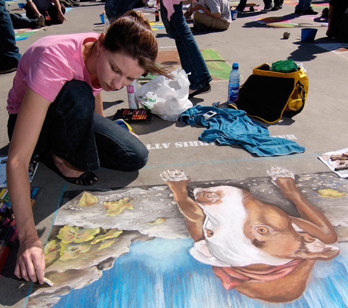A LOCAL ARTIST displays her work at a recent Providence Rotary Club Street Painting Festival. / COURTESY PROVIDENCE ROTARY CLUB