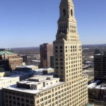 CONNECTICUT LAWMAKERS passed a veto-proof budget that provides $50 million in financial aid to Hartford, Conn. Above, the Travelers Property and Casualty headquarters in Hartford, Conn. / BLOOMBERG FILE PHOTO/GEORGE RUHE