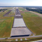 ON THE HORIZON: An aerial view of the completed expansion of the main runway at T.F. Green Airport, lengthened from 7,200 feet to 8,700 feet, allowing for the ability to fly nonstop to the West Coast, as well as opening up opportunities for expanded international trade and domestic commerce. / COURTESY R.I. AIRPORT CORP.