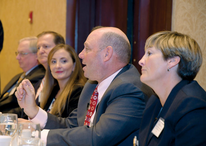 CYBER SOLUTIONS: Linn Foster Freedman, right, a partner with Robinson+Cole, looks on as Jeff Ziplow, center, cybersecurity risk assessment officer with BlumShapiro, answers a question during the PBN Cybersecurity Summit at the Crowne Plaza Providence-Warwick on Oct. 31. / PBN PHOTO/MICHAEL SKORSKI