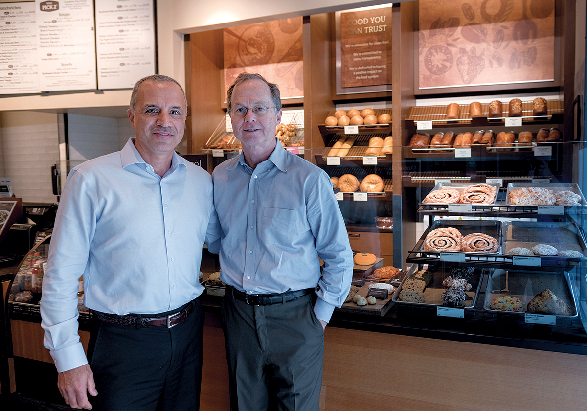 PARTNERS: Operating partner Bahjat Shariff, left, and Senior Vice President Tom Howley of the Howley Bread Group, franchisee for Panera Bread in New England stores, at the Panera Bread in Cranston. / PBN PHOTO/MICHAEL SALERNO