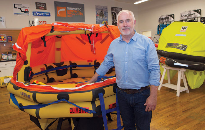 ONE-STOP SHOP: Jim O'Connor is the owner of Life Raft & Survival Equipment Inc. in Tiverton. The company not only sells protective gear to mariners but also maintains and inspects it, which is required yearly for commercial vessels. / PBN PHOTO/KATE WHITENEY LUCEY