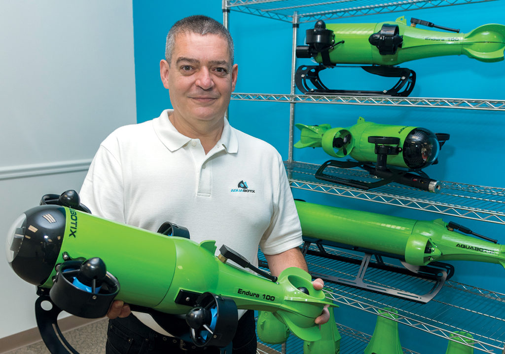 DEEP RANGE: Durval Tavares, founder of Fall River-based Aquabotix Technology Corp., holds the underwater-drone company's Endura 100, with a depth range of 100 meters. / PBN FILE PHOTO/MICHAEL SALERNO