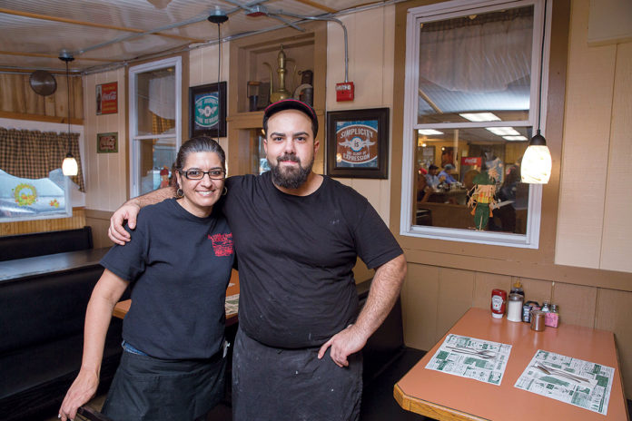 DEDICATED: Owner Christos Kirios and waitress Brenda Richer at the Middle of Nowhere Diner in Exeter. Kirios says he works in the kitchen six days a week because it sends a message to the employees that the owner is involved. / PBN PHOTO/