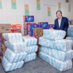 UNDERCOVER INVENTORY: Richard Fleischer, president of Project Undercover, which supplies diapers, underwear, socks and wipes to families in need, stands among the nonprofit's inventory at its Providence warehouse.  / PBN PHOTO/MICHAEL SALERNO