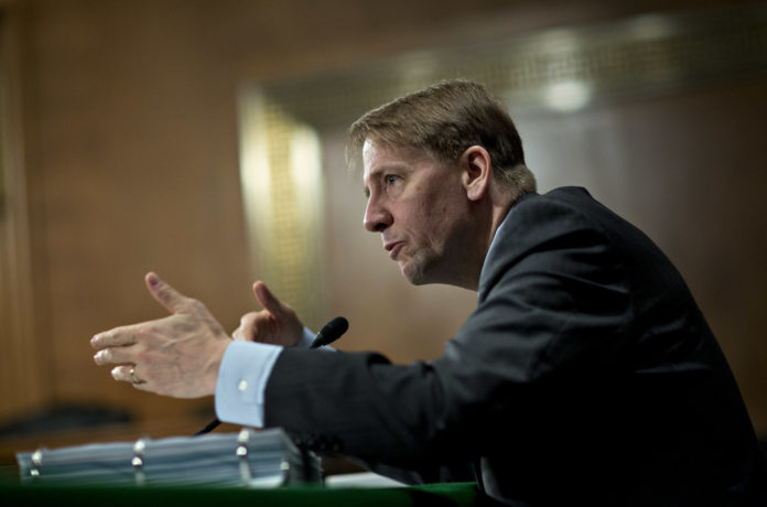 RICHARD CORDRAY, director of the Consumer Financial Protection Bureau will step down at the end of the month. / BLOOMBERG FILE PHOTO/ANDREW HARRER