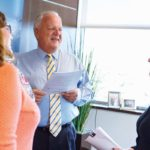"""PROSPEROUS HISTORY: William A. """"Bill"""" White, Coastway president and CEO, speaks with Katie MacDonald, left, marketing manager, and Jeanette Fitz, chief financial officer, at the bank's Providence office.  / PBN PHOTO/RUPERT WHITELY"""