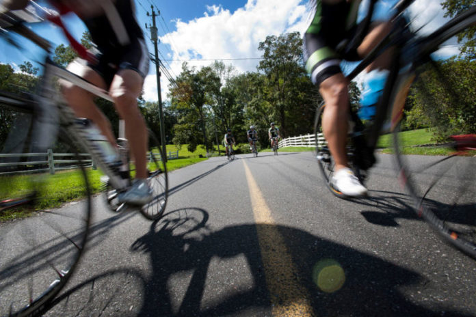 BICYCLING IS ONE of several forms of active transportation that will be discussed at a workshop by Grow Smart Rhode Island at NeighborWorks Blackstone River Valley in Woonsocket on Nov. 13. / BLOOMBERG FILE PHOTO/PAUL TAGGART