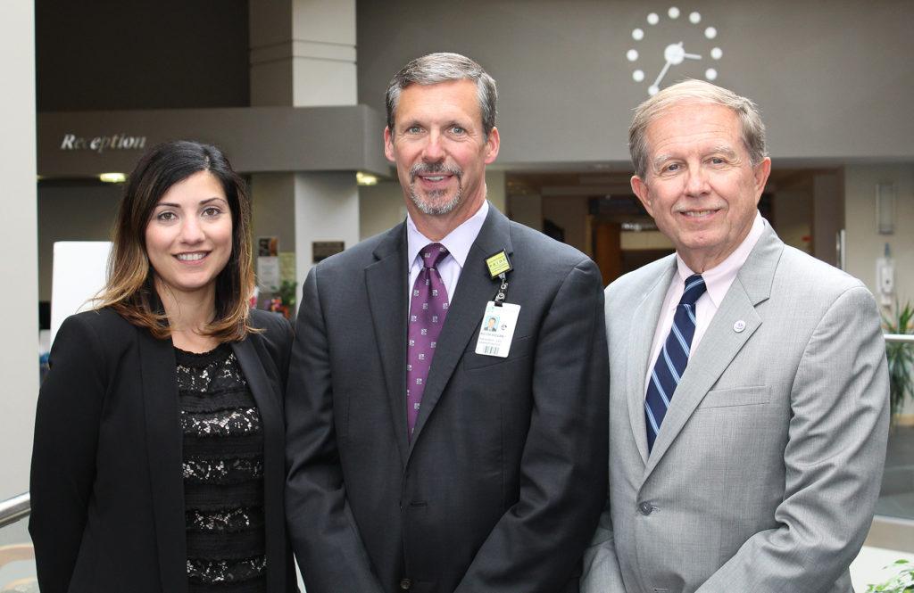 Andrea Amaral Rodrigues, vice president and marketing manager at BankFive (left), Keith A. Hovan, president & CEO of Southcoast Health (center), and William R. Eccles, Jr., president & CEO at BankFive recently pose for a photo at Charlton Memorial Hospital. / COURTESY BANKFIVE