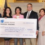 RHODE ISLAND MEDICAL IMAGING recently donated $10,000 to the R.I. Department of Health to expand breast cancer screening for low-income women. From left, Dr. Robert Ward, Rhode Island Medical Imaging; Dr. Ana Lourenco, Rhode Island Medical Imaging; Gov. Gina M. Raimondo; Dr. John Pezzullo, president, Rhode Island Medical Imaging; Carol Hall-Walker, R.I. Department of Health; and Brenda Di Paolo, RIDOH. / COURTESY R.I. DEPARTMENT OF HEALTH