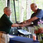 RUDI HEMPE, left, of North Kingstown accepts the award for University of Rhode Island Master Gardener of the Year from Charlie Junod during the Master Gardener 40th anniversary celebration. / COURTESY SUE DUNN