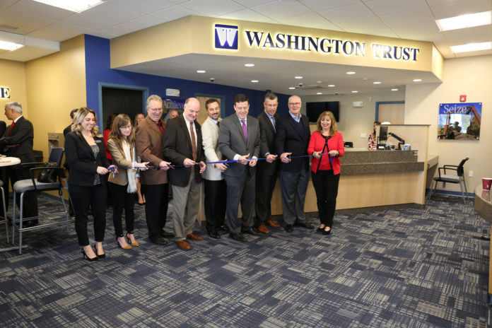THE WASHINGTON TRUST CO. executives celebrate the opening of its new Coventry branch during a ribbon-cutting ceremony with elected officials. /COURTESY WASHINGTON TRUST