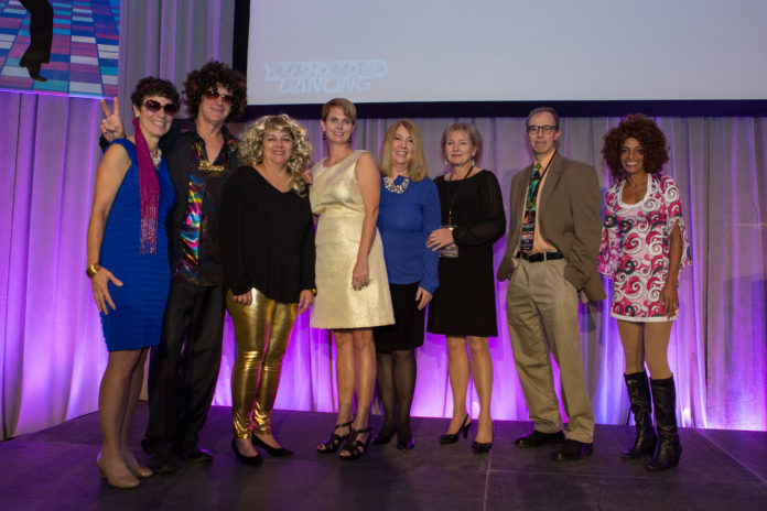 CLINICIANS FROM WOMEN AND INFANTS' Department of Obstetrics and Gynecology celebrated 70s style at You Should Be Dancing. Pictured left to right are Dr. Maureen Phipps; Dr. Paul DiSilvestro, Dr. Deborah Myers, Dr. Kristen Matteson, Elisabeth Howard, Dr. Katharine Wenstrom, Dr. Ruben Alvero and Dr. Roxanne Vrees. / COURTESY WOMEN & INFANTS HOSPITAL