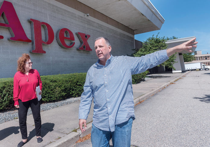PROPOSED SITE: The Apex Department Store building in Pawtucket, the proposed location of a new PawSox ballpark, can be seen in the background during a walking tour of the city's downtown area with Mayor ­Donald R. Grebien and Commerce Director Jeanne Boyle. / PBN PHOTO/MICHAEL SALERNO