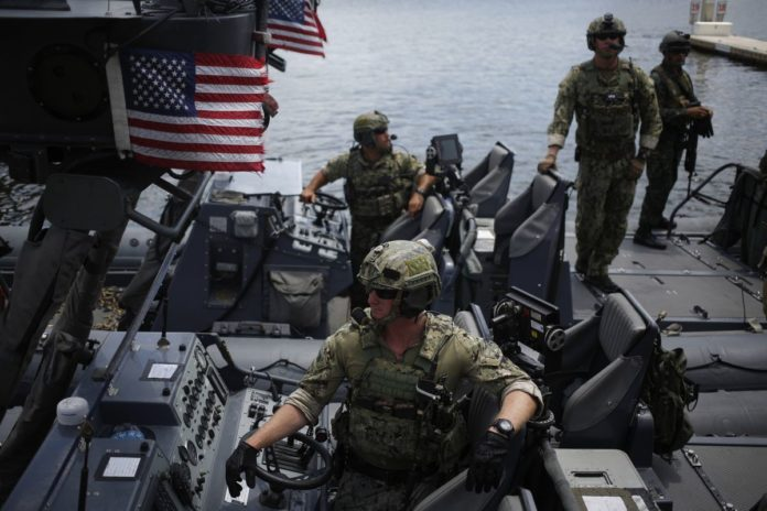 THE GOVERNMENT ACCOUNTABILITY OFFICE said that the $128 billion Columbia-class nuclear-powered submarine appears to be underfunded and is at risk for increased costs and schedule delays. Above, U.S. Navy Special Warfare Combatant-Craft Crewmen ride aboard a Rigid Hull Inflatable Boat after participating in an International Special Operations Forces capacities exercise. / BLOOMBERG FILE PHOTO/LUKE SHARRETT