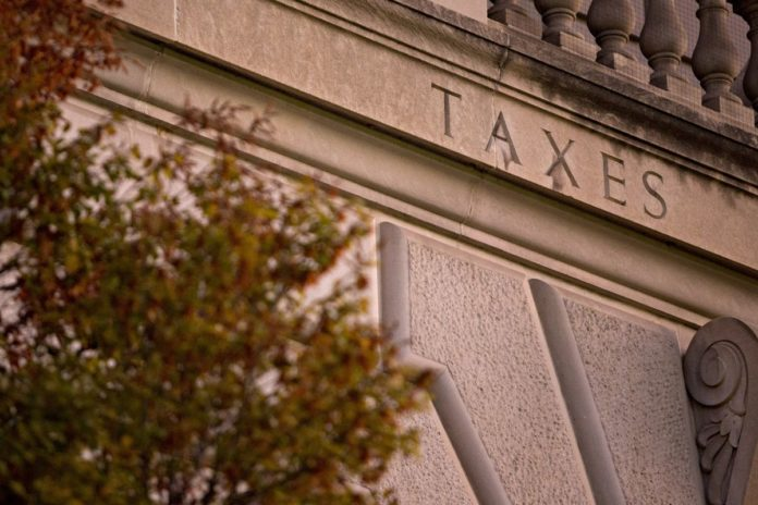 THE IRS has said that taxpayers can deduct their 2018 state and local property taxes on their 2017 returns if they pay those tax bills before the end of the year and if the taxes were assessed before 2018. / BLOOMBERG FILE PHOTO/BLOOMBERG CREATIVE PHOTOS