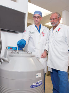 COLD CELLS: Dr. Steven Katz, left, surgical oncologist at the Roger Williams Medical Center, and Dr. N. Joseph Espat, director of the center, remove a specimen from liquid nitrogen storage, where cells are preserved at -321 degrees Fahrenheit. / COURTESY ROGER WILLIAMS MEDICAL CENTER