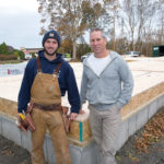 FAMILY BUILDERS: Sweenor Builders owner Jeff Sweenor, right, with his son, Ryan, who is framing this house under construction in Jamestown. Jeff started the company in 1989 after deciding his family's chocolate business was not his passion. / PBN PHOTO/KATE WHITENEY LUCEY